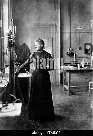 Marie Curie (1867-1934) Polish-born French physicist in her laboratory, 1912, the year after she was awarded her - Stock Photo