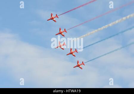 DUXFORD CAMBRIDGESHIRE UK 20 August 2015: Red Arrows in Display in line - Stock Photo