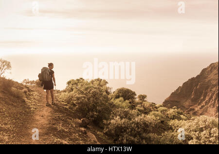 Gran Canaria: female hiker on mountain footpath with spectacular views. Canary Islands, Spain - Stock Photo