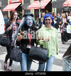 LONDON, ENGLAND - 31st October, 2016 The girl with blue hair on Halloween crossing the road at a pedestrian crossing - Stock Photo