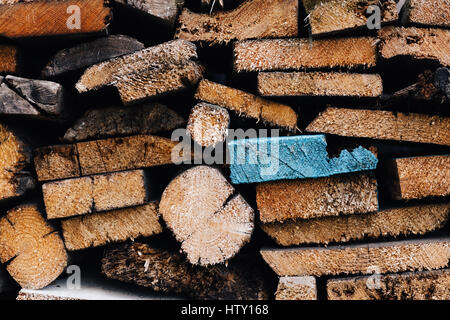 Backgrounds from the pile sawn planks for firewood. Different shapes and colors - Stock Photo