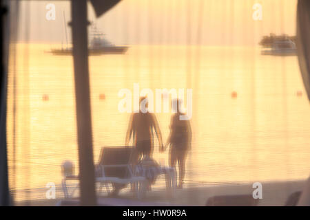 Couple with sunset, Negril, Jamaica - Stock Photo