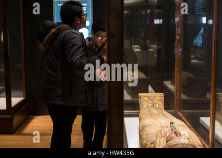New York, USA. 16th Mar, 2017. Children visit a painted coffin at the preview of the 'Mummies' exhibition at the - Stock Photo