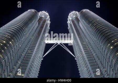 The twin spires of the Petronas Towers in Kuala Lumpur, Malaysia. - Stock Photo
