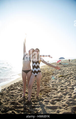 Playful girls on the beach in Italy - Stock Photo