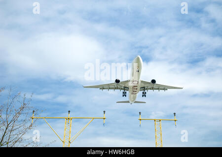 London, Heathrow - April 9, 2010: Qatar Airways Airbus A330 on landing approach to Heathrow, Britains busiest international - Stock Photo