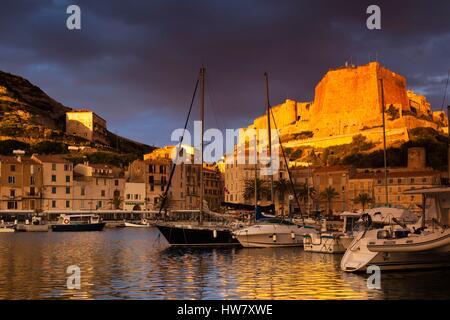 France, Corse du Sud, Corsica South Coast Region, Bonifacio, port and Citadel, sunrise - Stock Photo
