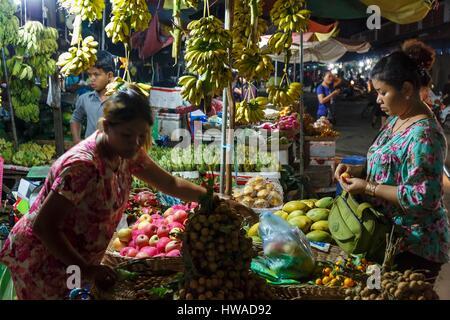 Cambodia, Kompong Thom province, Kompong Thom, woman selling fruits at the night market - Stock Photo