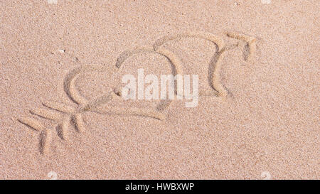 Two Hearts and arrow, We heart it, Drawn on Sand on the Beach, Bali, Indonesia - Stockfoto