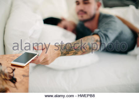Homosexual Couple Sleeping In Bed Close Up Stock Photo