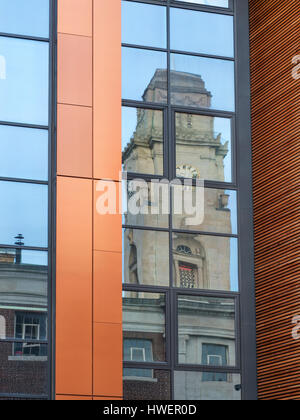Clock Tower at Barnsley Town Hall Reflected in the Window of a Modern Building Barnsley South Yorkshire England - Stock Photo