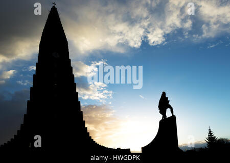Hallgrimskirkja Cathedral and Leif Eriksson Statue in Reykjavik, Iceland at dawn. The Lutheran (Church of Iceland) - Stock Photo