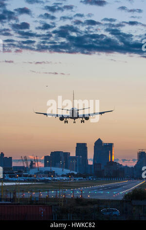 Airplane landing at London City Airport, UK - Stock Photo