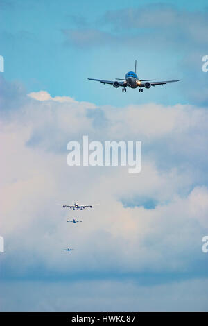 Commercial airplanes landing at London Heathrow Airport, UK - Stock Photo