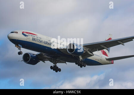 British Airways Boeing 777-236/ER landing at London Heathrow Airport, UK - Stock Photo