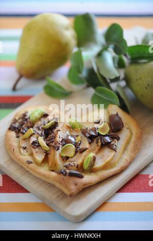 Pizza poire chocolat pistache - Stock Photo
