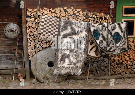 Traditional Romanian woven fabric blanket from Maramures region - Stock Photo