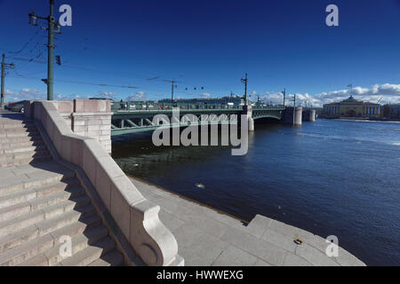 St. Petersburg, Russia, 23rd March, 2017. Palace bridge in a sunny day during the first Ice drift on the river Neva - Stock Photo