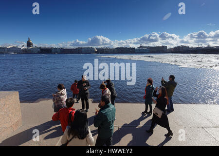 St. Petersburg, Russia, 23rd March, 2017. Chinese tourists make photos on the embankment of river Neva during the - Stock Photo