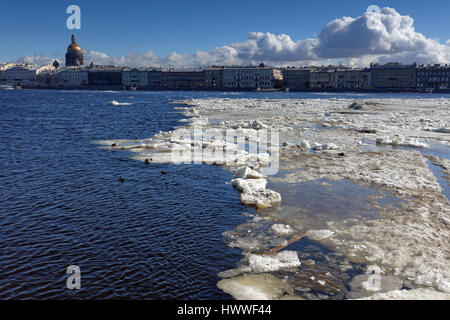St. Petersburg, Russia, 23rd March, 2017. Dome of St. Isaac's Cathedral over the city and river Neva in a sunny - Stock Photo