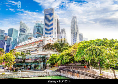 HDR Rendering of Singapore's Skyline at Fullerton taken on Esplanade Bridge over the Singapore River in the downtown - Stock Photo
