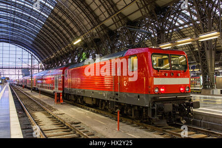Electric locomotive with regional train in Frankfurt, Germany - Stock Photo