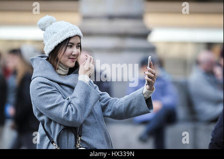 Asian woman take selfie photo near the La republica. Over 1 Million selfies are taken each day Instagram, in Florence, - Stock Photo