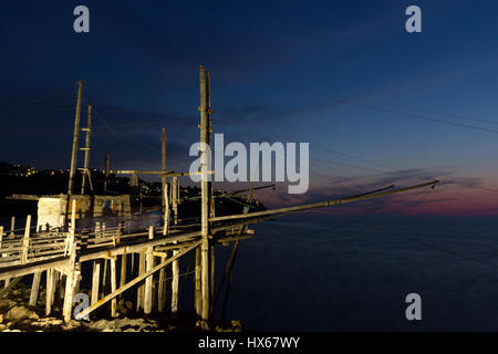 A night view of a typical trabucco, an apulian wooden construction for fishing by a system of nets - Stock Photo