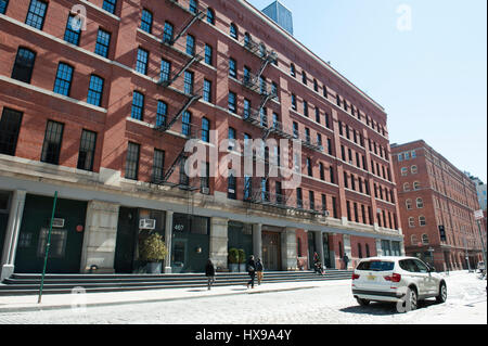 Greenwich Street in Tribeca, a formerly commercial neighborhood, now residential, on a sunny day in early spring. - Stock Photo