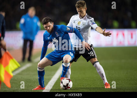 Baku, Azerbaijan. 26th Mar, 2017. Germany's Joshua Kimmich (R) and Azerbaijan's Javid Huseynov vie for the ball - Stock Photo