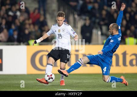 Baku, Azerbaijan. 26th Mar, 2017. Germany's Joshua Kimmich (L) and Azerbaijan's Pavlo Pashayev vie for the ball - Stock Photo