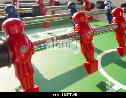 Table football game with red and blue players team in table soccer or football kicker game, - Stock Photo
