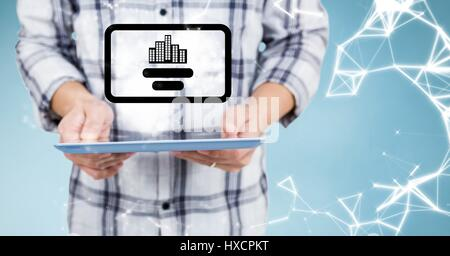 Digital composite of Man mid section with tablet, flare and interface against blue background - Stock Photo