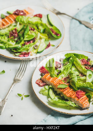 Healthy energy boosting spring salad with grilled salmon, orange, quinoa - Stock Photo