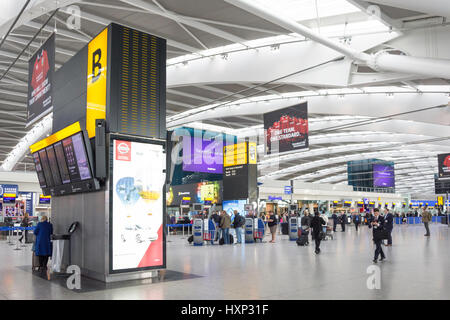 Departures level at Terminal 5, London Heathrow Airport. London Borough of Hillingdon, Greater London, England, - Stock Photo