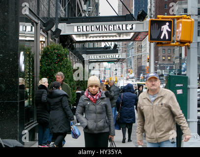 New York, December 08: People walk by an entrace to the famous Bloomingdale's department store. - Stock Photo