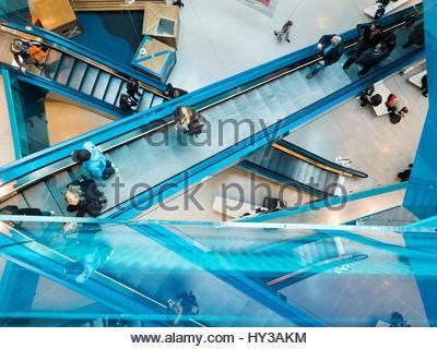 Sweden, Skane, Malmo, People moving on escalator - Stock Photo