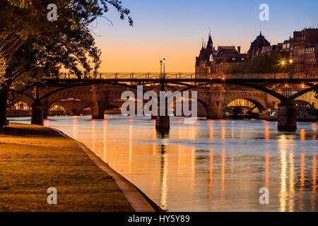 Sunrise on the Seine River banks, Pont des Arts and Pont Neuf in the 1st Arrondissement of Ile de la Cite, Paris, - Stock Photo