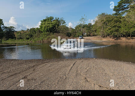 Car at a river crossing near Drake, Costa Rica - Stock Photo