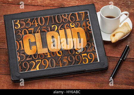 cloud computing concept - word in vintage letterpress wood type against number background on a digital tbalet with - Stock Photo