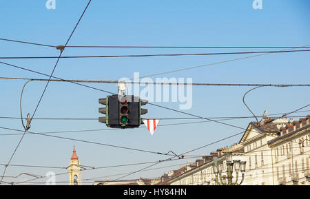 Red and green traffic lights against blue sky and cities backgrounds - Stock Photo