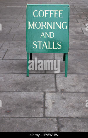 COFFEE MORNING: A sandwich board advertising a coffee morning and stalls - Stock Photo