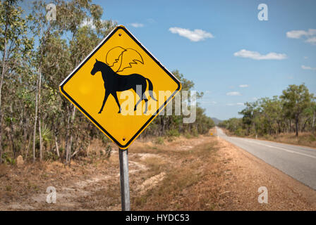 Humorous defaced warning sign showing winged horses ahead. Northern Territories, Australia - Stock Photo