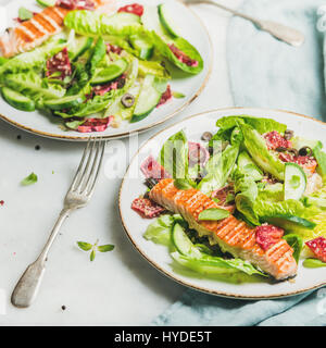Healthy spring salad with grilled salmon, orange and quinoa - Stock Photo