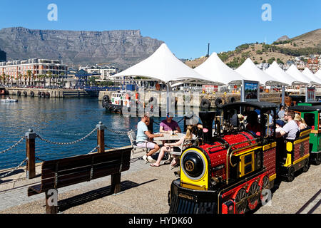 Waterfront with tourist train and Table Mountain,Cape Town, Western Cape, South Africa - Stock Photo