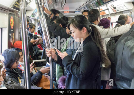 passengers on the PATH train from New Jersey to Manhattan - Stock Photo