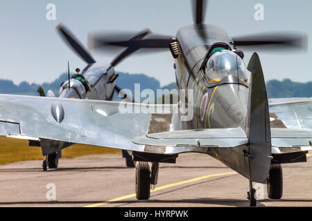 A pair of Supermarine Spitfires taxying on July 13th 2013 at Duxford, Cambridgeshire, UK - Stock Photo