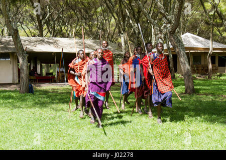 Ngorongoro Conservation Area, Tanzania - March 8, 2017 : Maasai village warriors in ceremony in Ngorongoro Conservation - Stock Photo