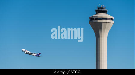 FedEx Express jet taking off from Memphis International Airport in Memphis, Tennessee, USA. - Stock Photo