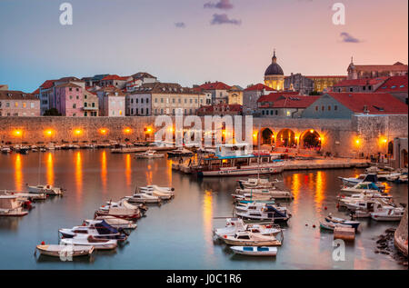 Fishing boats at sunset in the Old Port, Dubrovnik Old Town, UNESCO World Heritage Site, Dubrovnik, Dalmatian Coast, - Stock Photo